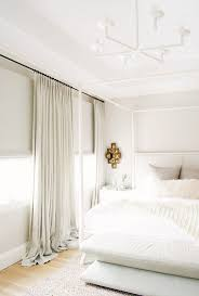 Curtains Hung Inside Window Frame 7 Tricks All Designers Use To Make Your Bedroom Look Expensive