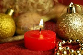a line of seven burning christmas ornament candles stock photo