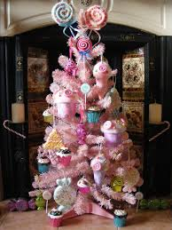 candy pink christmas tree with cupcakes lollipops candies and