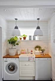 white shiplap small laundry room with center sink laundry and