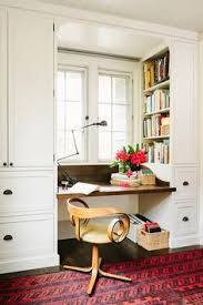Home Office Interior Design Ideas by Chic Home Office Features A Built In Desk Adorned With Bronze