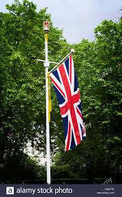 Front Porch Flag Pole Union Jack British Flag On Flag Pole With Trees In Background