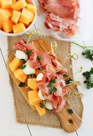 the comfort of cooking melon proscuitto and mozzarella skewers
