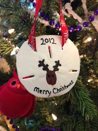 reindeer thumb print on sand dollar ornament crafts i love