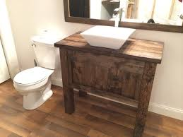 rustic farmhouse bathroom vanity with vessels sink and free fall