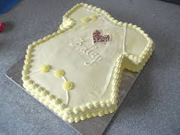 baby onesie cake a baby cake baking and food decoration on cut