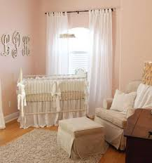 elegant vintage antique white and pink nursery for a baby