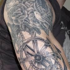 roses and wheel arm tattoo tattoomagz