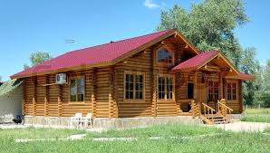 porch of the big wooden house combined from logs stock photo