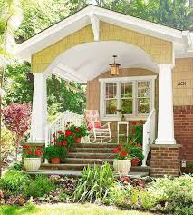 house porch design with brick steps and pots and lantern home