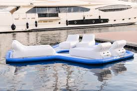 funair climbing wall yacht slide and floating island at flibs the funair floating island on display in the water at monaco yacht show