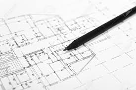 plans for residential flats with pencil closeup stock photo