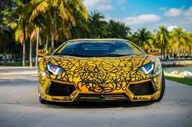 yellow lamborghini front art cars of art basel in miami shows huracan and aventador