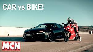 bugatti bike car audi r8 vs bike ducati panigale 1199r feature
