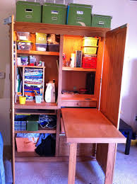 craft cabinet with fold out table best solutions of an old puter armoire turned into a craft storage