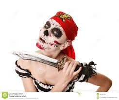 halloween stock background woman pirate with a sword costume for halloween stock photo