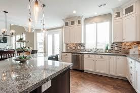 granite countertops with white cabinets new caledonia granite countertops for kitchen explores colors of