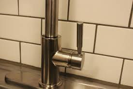 how to upgrade and install your kitchen faucet kitchen sprayer faucet closer look to base