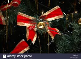 christmas tree decorations with gold and red ribbon bow and tinsel