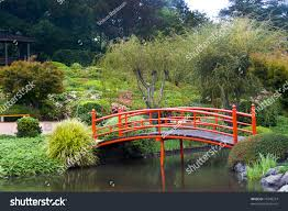 japanese style gardens red bridge over stock photo 75240214