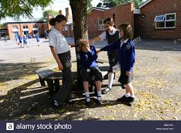 classmates search school playground being bullied by classmates stock