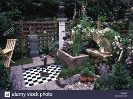 decorative owl water feature courtyard garden with small water