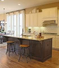 kitchen island with kitchen island with corbels in knotty alder by burrows cabinets
