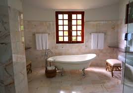 White On White Bathroom by White Bathtub On White Tile Bathroom Near Brown Framed Clear Glass