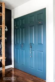 Paint Closet Doors Blue Closet Doors With Hooks In The Boy S Bedroomfunky Junk Interiors