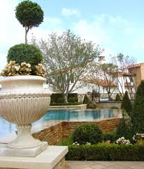 pretty urn planters in landscape traditional with low cost house