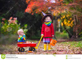 kids trick or treat at halloween stock photo image 59487326