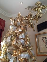 gold tree with cherub toppers exquisite professional