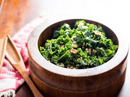 kale salad with oven dried grapes toasted walnuts and blue
