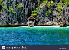 lonely wooden bamboo house on stilts at a small hidden beach of