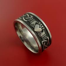 titanium celtic wedding bands titanium celtic claddagh ring clasping a band