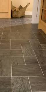 i want black laminate flooring that looks like tile upstairs
