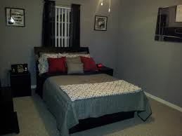 decorating room with gray paint ideas in modern home design black bedstead with gray bedcover also red pillows and headboard also gray wall bedroom paint inspirations