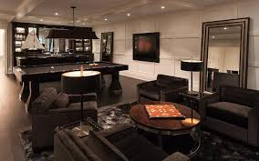 contemporary basement family room with black velvet tufted chairs