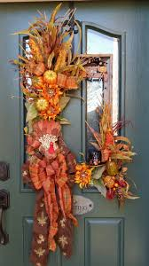 67 cute and inviting fall front door decor ideas digsdigs a beautiful fall harvest arrangement could be hanged right on a door
