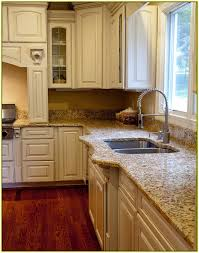 brown granite countertops with white cabinets white kitchen cabinets with brown granite countertops home design