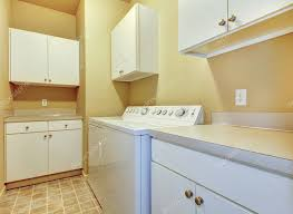 yellow kitchen walls white cabinets laundry room with white cabinets and yellow walls 11404554