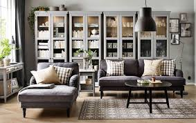 Living Room Furniture Chaise Lounge A Living Room With A Grey Three Seat Sofa Chaise Lounge And A