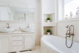 light bathroom with two sinks and big mirror stock photo picture