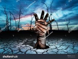 magic halloween background zombie hand through soil cracked magic stock photo 329032421