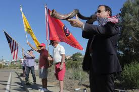 rams horn trumpet wiley blows a rams horn trumpet called a shofar during a