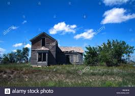 old abandoned wooden american house on the great plains in