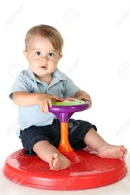 adorable 1 year old boy playing with spinning toy stock photo