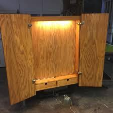 under cabinet lighting trim dart board cabinet with lights roselawnlutheran