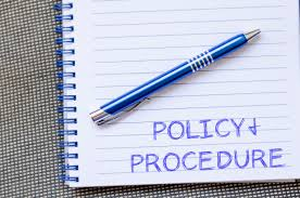 writing policy papers policies procedures and protocols policy and procedure text concept write on notebook with pen