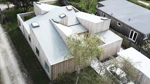 sigurd larsen u0027s roof house features intersecting slanted roofs